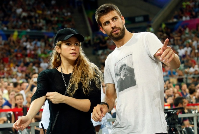 Colombian singer Shakira and her partner, Barcelona soccer player Pique, attend the Basketball World Cup quarter-final game between the U.S. and Slovenia in Barcelona